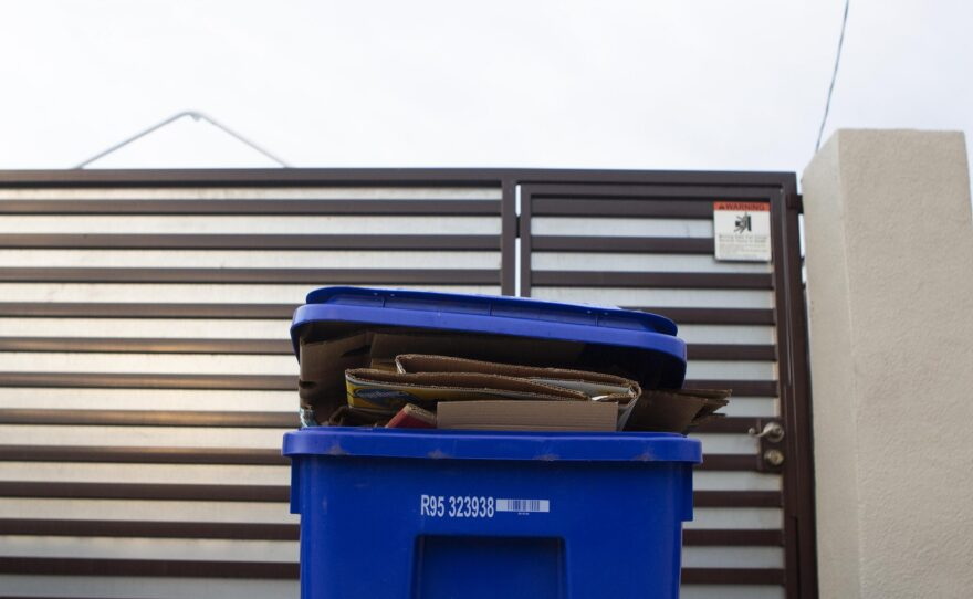 Recycling containers are put out for pickup in City Heights, Feb. 12, 2020.