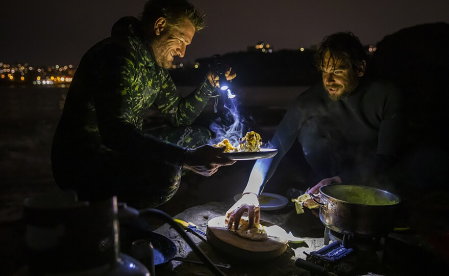 At dusk, Curtis Stone and Chef Mark LaBrooy of Three Blue Ducks dive for lobsters and enjoy a seaside dinner.