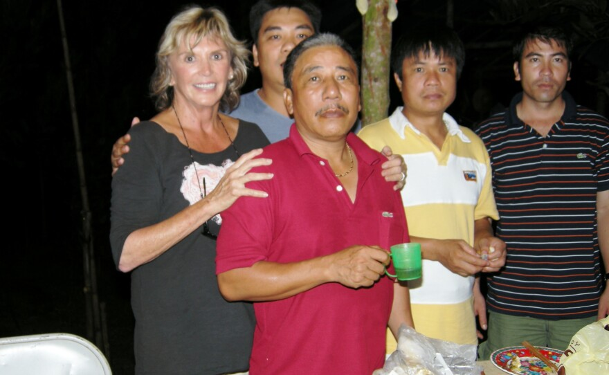 Elaine Zimmer Davis stands with Vietnamese counterparts of the U.S. Joint POW/MIA Accounting Command during a visit to Vietnam in August 2010.