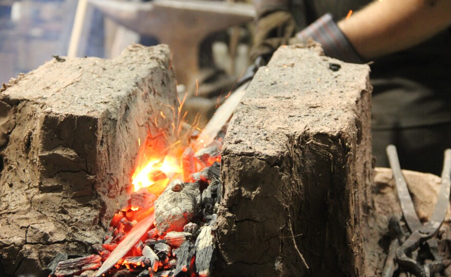 Blacksmith Ric Furrer heats the crucible Ulfberht blade in a traditional brick forge.