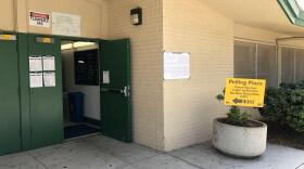 A sign showing a polling location in San Diego is displayed, June 5, 2018.
