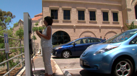A woman charges her electric vehicle in Balboa Park, June 27, 2017.