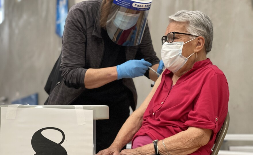 A patient gets vaccinated against COVID-19 at Border View Family YMCA in Otay Mesa, Calif. Feb. 24, 2021.