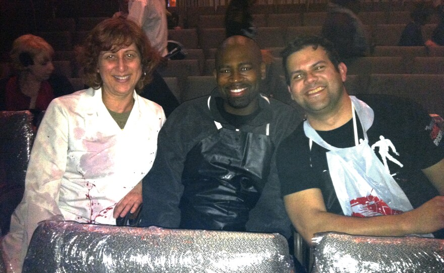 "Beth Accomando, Sanns Dixon, and Phil Lorenzo sitting in the ""Splash zone"" for ""Re-Animator: The Musical."""