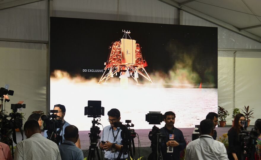 Members of the press cover the launch of the solar-powered rover Chandrayaan-2 in September. The goal was a moon landing, but the craft crashed. Another attempt to send a rover to the moon is underway.