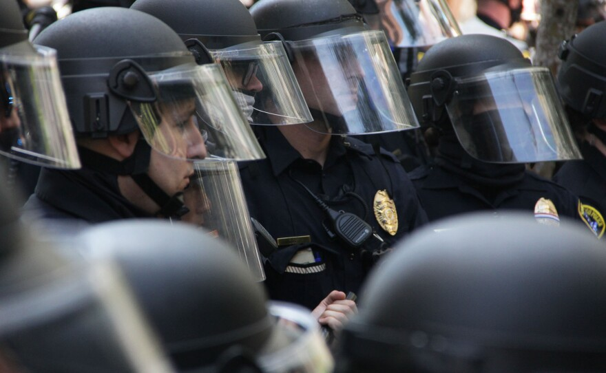 San Diego police officers monitor protesters during a demonstration against police brutality, San Diego, June 1, 2020.