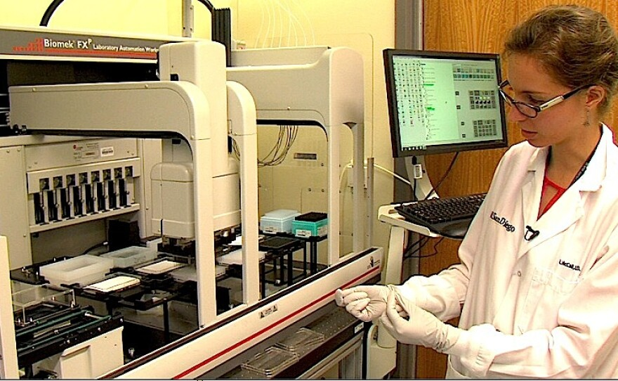 Post-doctor fellow Laura-Isabel McCall operates a drug discovery robot inside the UCSD lab, on August 20, 2015.