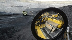 A coal hauling truck with 240 tons of coal drives to the surface at the Buckskin Coal Mine in Gillette, Wyo., May 5, 2004.