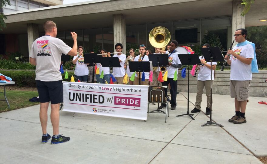 Russ Sperling, director of San Diego Unified's Visual and Performing Arts Department, leads band students during practice for the San Diego Pride Parade, July 14, 2016.