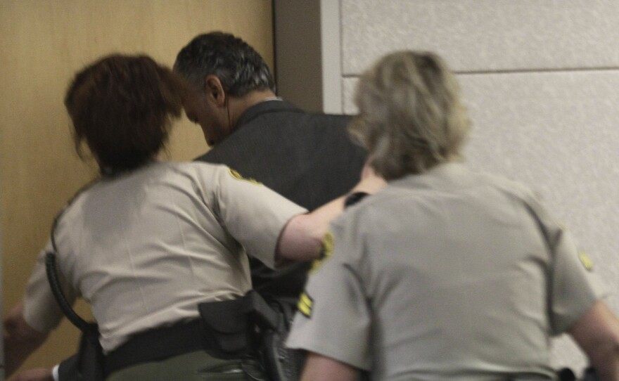 Actor Shelley Malil is led out of the courtroom after being found guilty in an attempted murder trial in Vista, Thursday, Sept. 16, 2010.