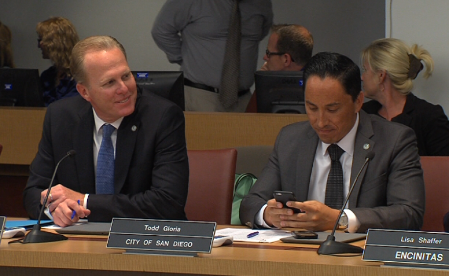San Diego Mayor Kevin Faulconer, left, and City Councilman Todd Gloria sit at a meeting of the SANDAG board, April 29, 2016.