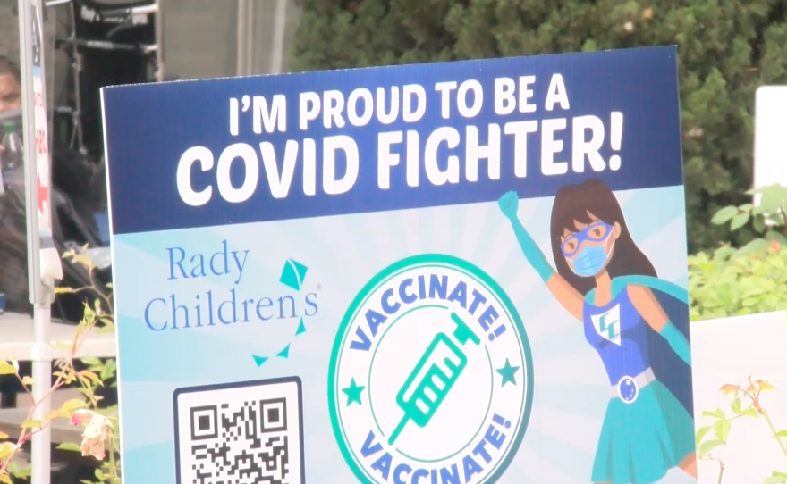 """A sign is pictured outside of Rady Children's hospital reading """"I'm proud to be a COVID fighter,"""" June 18, 2021."""