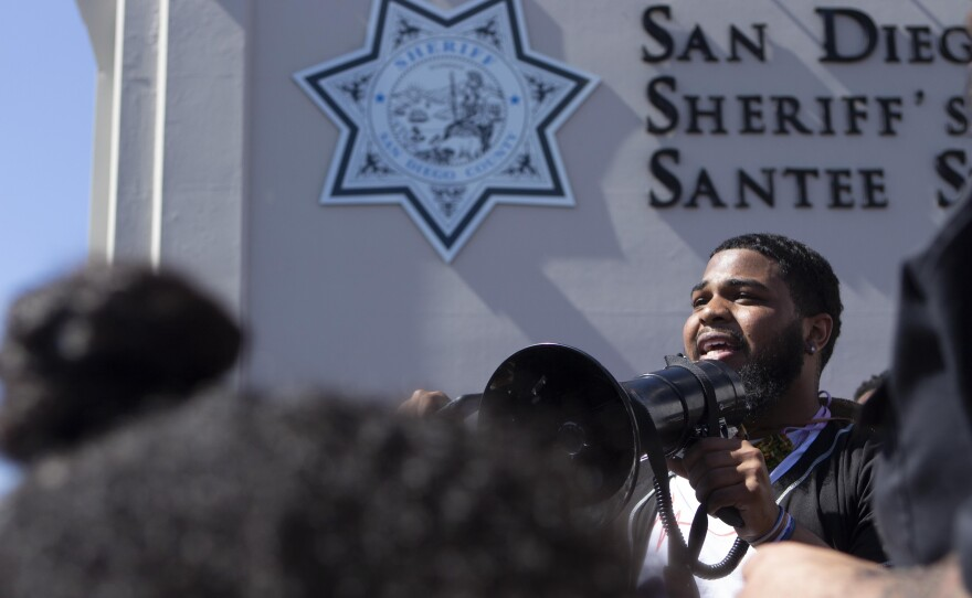 Demonstration coordinator 24-year-old Jay Wyatt of Spring Valley speaks outside the San Diego Sheriff's Department station in Santee, June 7, 2020.