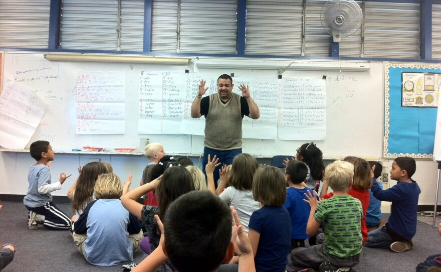 Spanish Teacher Juan Tirado works with first graders at McKinley Elementary, May 2, 2012. Language instruction is a requirement for authorized International Baccalaureate schools, which means IB principals have to find the money to pay for the additional teachers.
