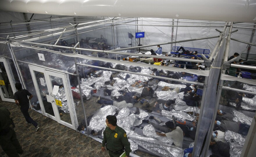 In this March 30, 2021, file photo, young minors lie inside a pod at the Donna Department of Homeland Security holding facility, the main detention center for unaccompanied children in the Rio Grande Valley run by U.S. Customs and Border Protection (CBP), in Donna, Texas.