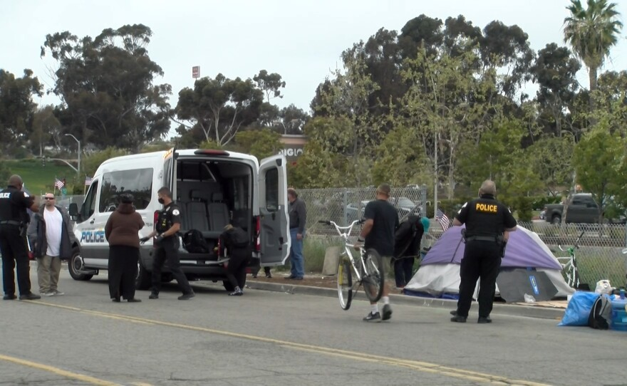 Oceanside Police Department's Homeless Outreach Team helps clear out people living at the homeless encampment on South Oceanside Blvd. and transports them to motels. April 13, 2021.