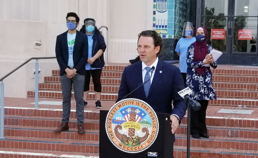 Supervisor Nathan Fletcher in front of the County Administration Building on Aug. 25, 2020, proposing funding for additional services for those affected by the COVID-19 pandemic.
