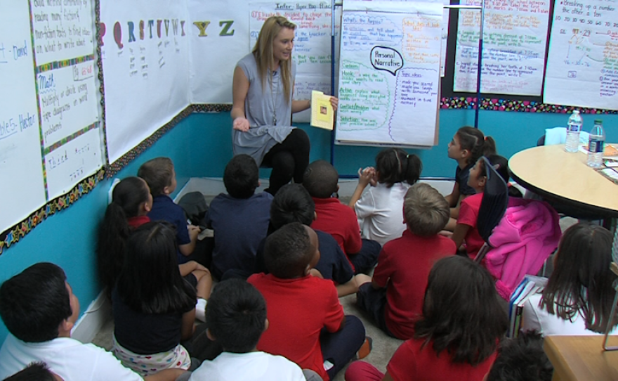 America's Finest Charter School teacher Cassandra Tinyo prepares to read a story to her third-grade class on Nov. 2, 2015.