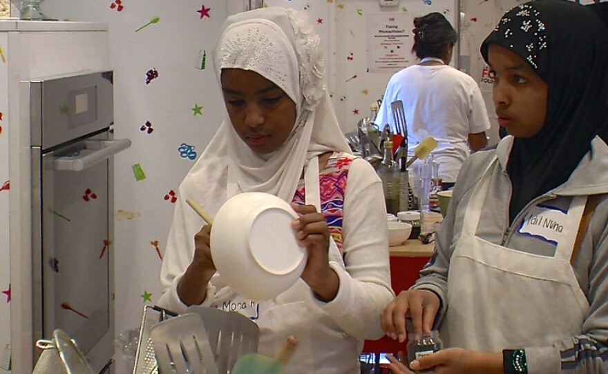 Muslim residents learned to make pancakes May 31, 2014 in a teaching kitchen brought to Hoover High School by Jamie Oliver's Food Revolution. To make the dish halal, participants substituted fruit salad for gelatinous artificial syrup and skipped the bacon.