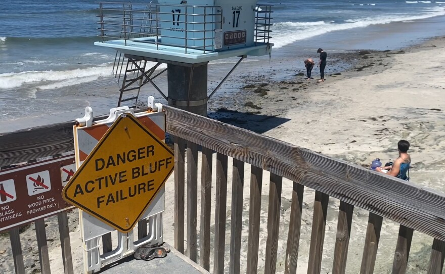 """A sign at San Elijo State Beach stating, """"Danger Active Bluff Failure."""" April 29, 2021."""
