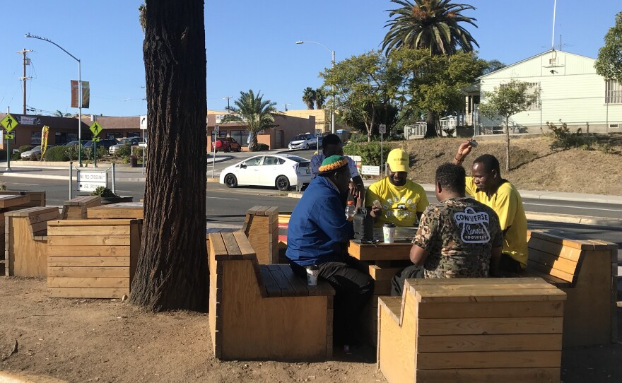 A group of men play a board game at a gathering space in City Heights created under San Diego's placemaking ordinance in this photo taken on Oct. 21, 2019.