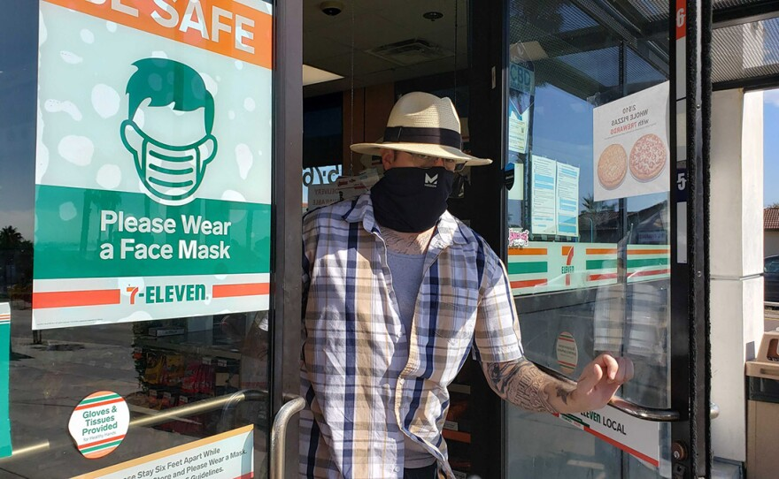 Man walking out of 7-Eleven in Bay Park on Aug. 1, 2020. The business, like many others in the county, is requiring customers to wear a mask before entering the premises to slow the spread of the coronavirus.