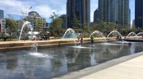 People cool off at Waterfront Park in front of the San Diego County administration building, March 16, 2015.