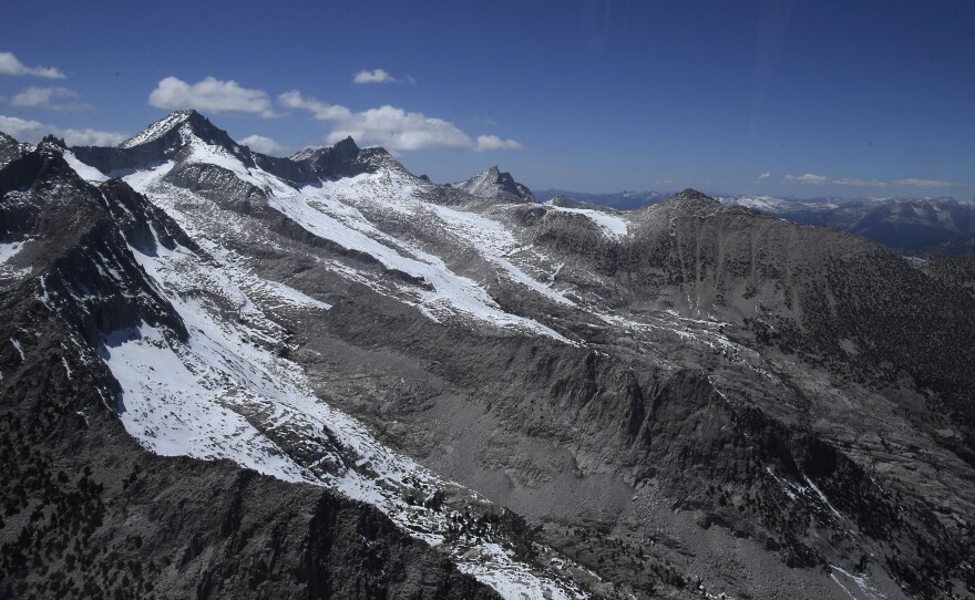Nearly snow barren ridges of the Sierra Nevada are seen near the Sequoia National Park during an aerial survey of the snowpack done by the Californian Department of Water Resources, April 28, 2015.
