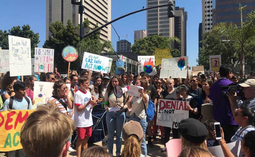 San Diego high school students speak after walking out as part of the Global Climate Strike, Friday, September 20, 2019.