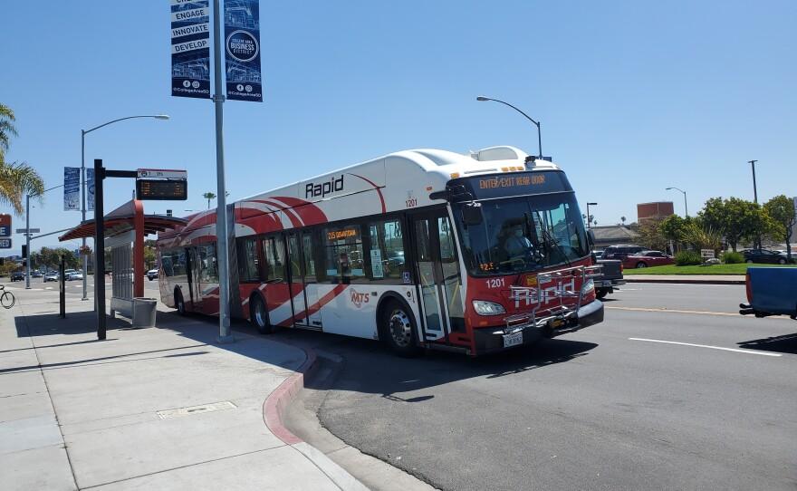 A bus pulls up to a stop on El Cajon Boulevard, April 16, 2020.