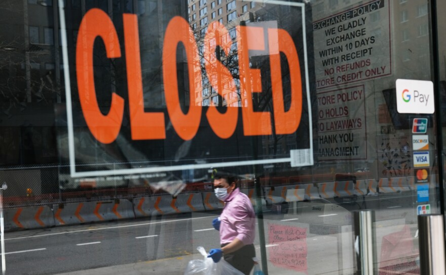 A closed sign is displayed in the window of a business in a nearly deserted lower Manhattan on April 17, 2020, in New York. Many small businesses benefitted from a government emergency loan program during the pandemic, but its effectiveness is still in doubt.