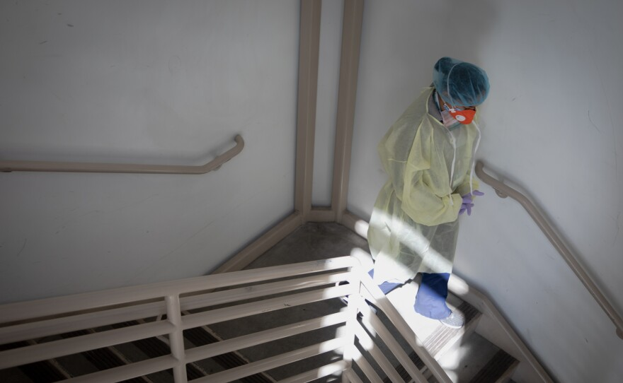 Quality Improvement Director Sonia Tucker walks down a staircase at La Maestra Community Health Centers' City Heights clinic, April 8, 2020.