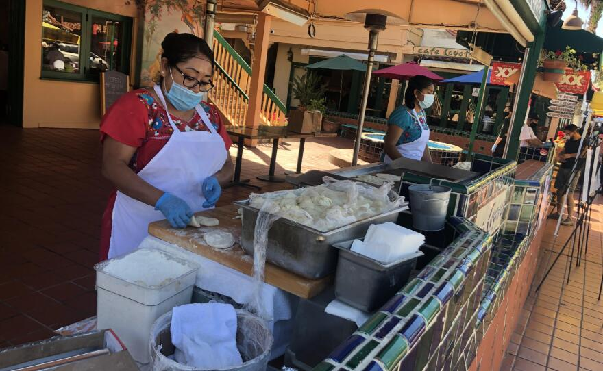 Restaurant workers in Old Town San Diego wear facial coverings due to COVID-19 restrictions in this undated photo.