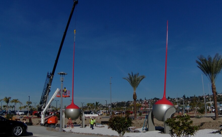 Workers put the finishing touches on new sculptures by Los Angeles-based artist Christian Moeller at the new San Diego International Airport Car Rental Center, Dec. 9, 2015.