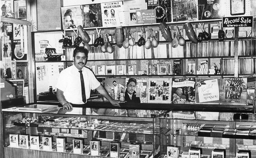 Mike Amadeo in his Bronx record shop, 1960s.