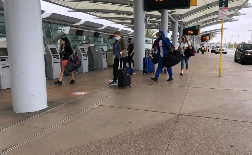 Passengers head to planes at the San Diego International Airport on June 24, 2020.