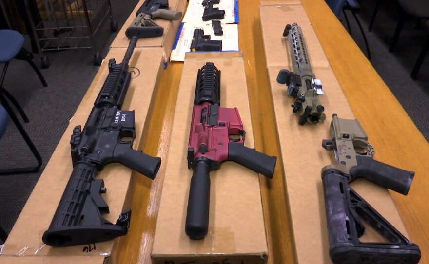 """This Nov. 27, 2019, file photo shows """"ghost guns"""" on display at the headquarters of the San Francisco Police Department in San Francisco."""