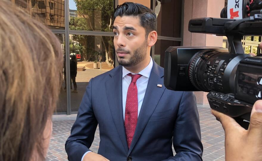 Ammar Campa-Najjar speaks with the media outside the federal courthouse downtown, August 23, 2018.