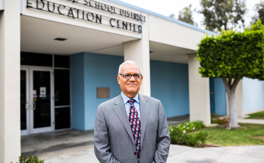 Rodolfo Linares stands in front of the San Ysidro School District offices in San Diego,  July 2015. He was elected to the board in 2014.