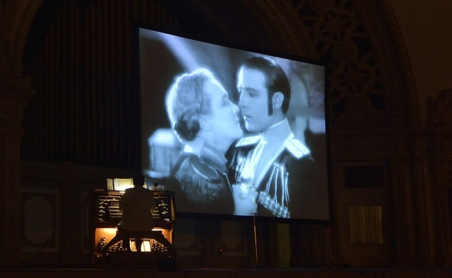 """An organist accompanies """"The Eagle,"""" starring Rudolph Valentino, at the Spreckels Organ Pavilion in Balboa Park on Silent Film Night last summer, Aug. 19, 2013."""
