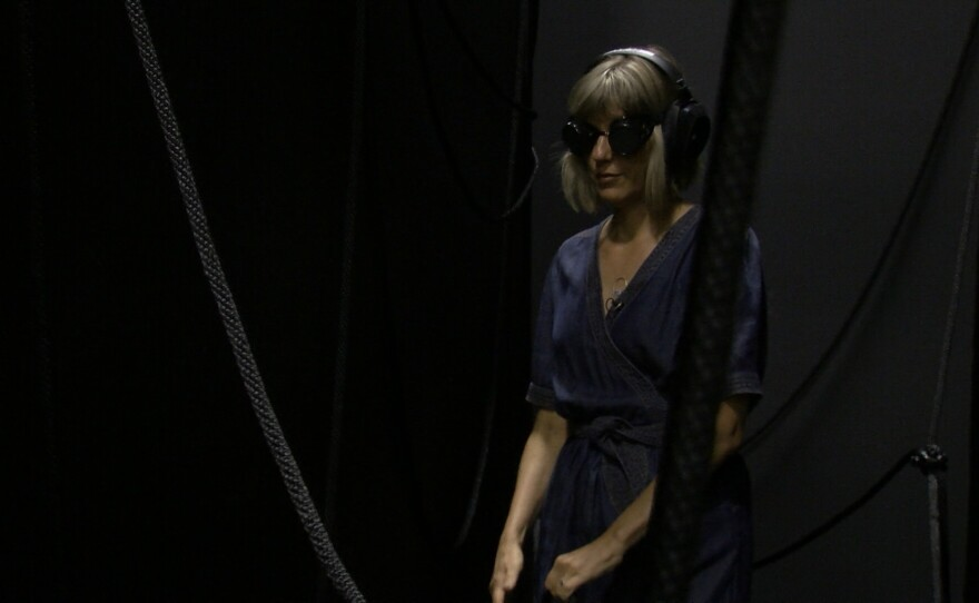 "Artist Margaret Noble navigates her own Wonderspaces exhibit ""Drift"" at B St Pier in San Diego, June 5, 2019."