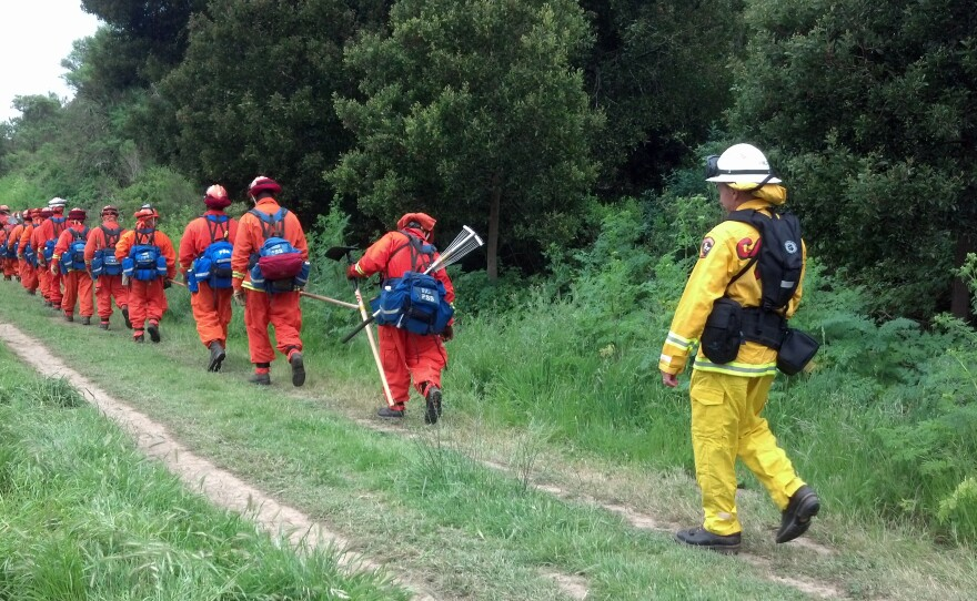 Incarcerated firefighters on a hike.