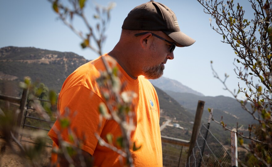 Steve Wallace looks out from his property line in Jamul, Sept. 1, 2021.