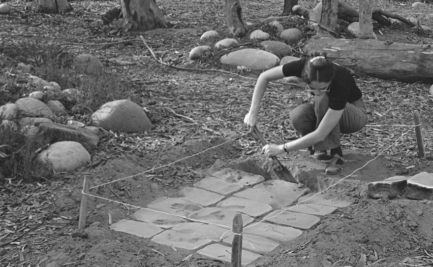 """UCSD graduate student Virginia Maksymowicz installing her anonymous sculpture """"Thirty Blocks"""" in 1976. Photo by Blaise Tobia."""