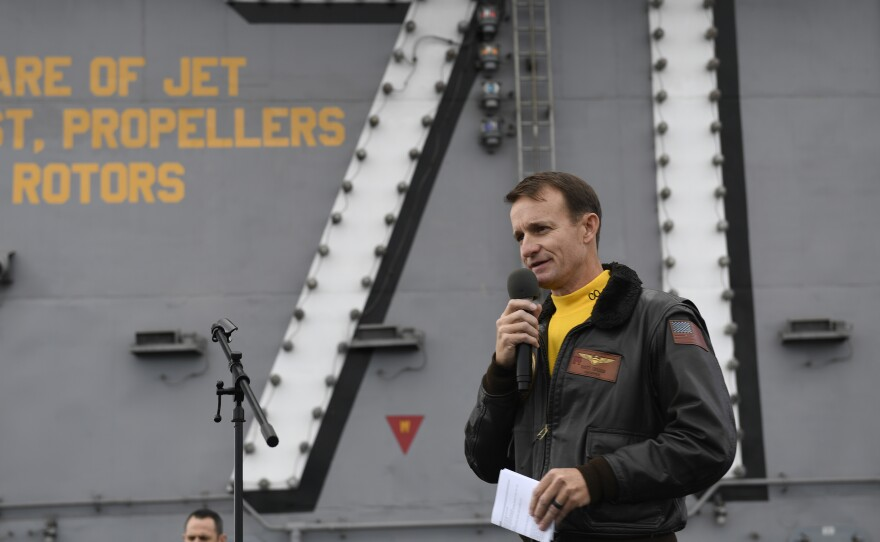 Navy Capt. Brett Crozier is pictured in November 2019 on the USS Roosevelt. Navy officials have not ruled out reinstating him. He was fired as commander of the aircraft carrier after complaining wasn't getting enough help containing the coronavirus on board.