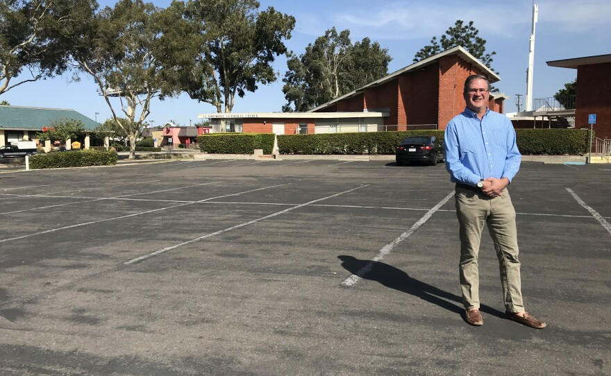 Jonathan Doolittle, senior pastor at Clairemont Lutheran Church, stands in the parking lot where his congregation wants to build affordable housing, Oct. 30, 2019.