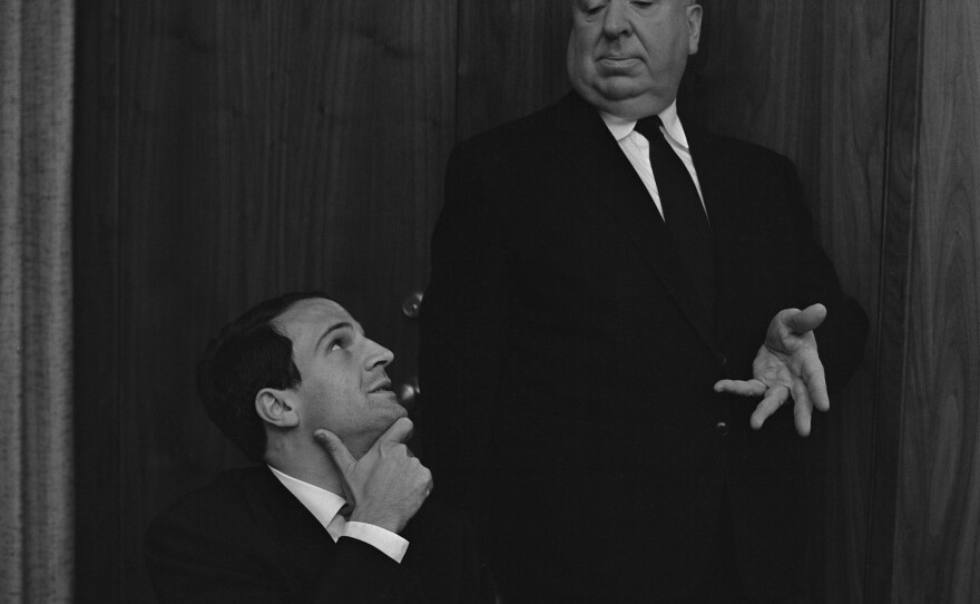 """One of the famous photos from the interview between Francois Truffaut and Alfred Hitchcock. Here Hitch """"directs"""" the French filmmaker to look up at him. The interview is now the basis of the documentary """"Hitchcock/Truffaut."""""""