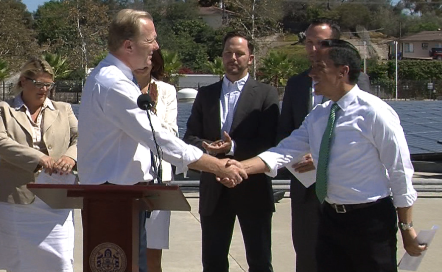 San Diego Mayor Kevin Faulconer shakes the hand of Council President Todd Gloria at a press conference unveiling the mayor's climate action plan, Sept. 30, 2014