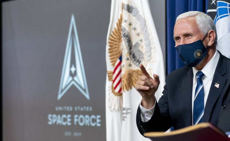 """Vice President Mike Pence arrives for a ceremony to commemorate the first birthday of the U.S. Space Force on Friday. Members of the branch will be called """"guardians."""""""