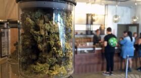 Customers buy products at a medical marijuana dispensary, April 20, 2016.